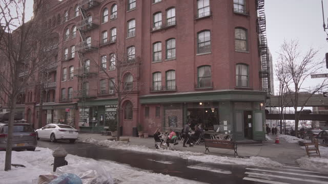 restaurant outdoor seating in brooklyn new york city during coronavirus pandemic on a cold winter day with snow. with people. waiter comes out of... - stay at home order stock videos & royalty-free footage