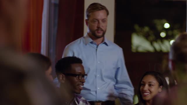 vídeos de stock, filmes e b-roll de restaurant owner checks in on dinner party - dono