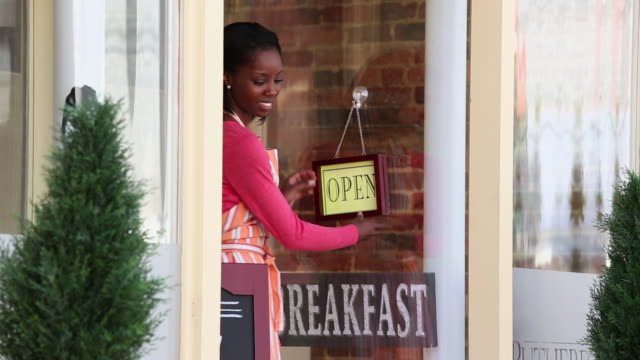 MS TD Restaurant Owner Placing Open Signs in Front of Shop / Petersburg, Virginia, United States