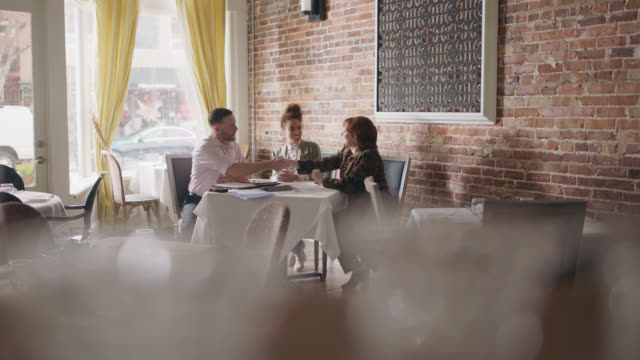 restaurant owner signs a contract with two businesswomen, they all shake hands - moustache stock videos & royalty-free footage