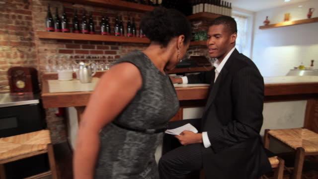 restaurant owners looking at paperwork - gastwirt stock-videos und b-roll-filmmaterial