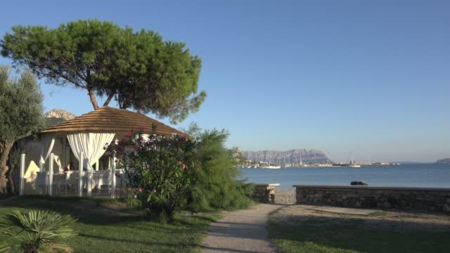 pan / restaurant pavilion at beach - sassari stock videos & royalty-free footage