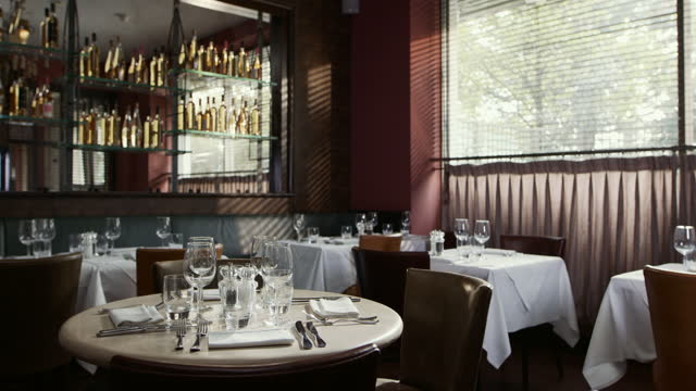 restaurant ready for customers with empty tables - table stock videos & royalty-free footage