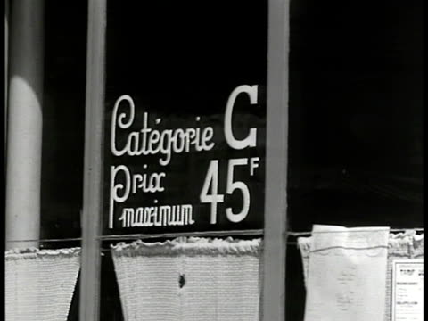 stockvideo's en b-roll-footage met restaurant cu restaurant minimum price '45 f' int french people at dinner tables cu cutting steak cu paper 'f 4' man counting money paying - 1946
