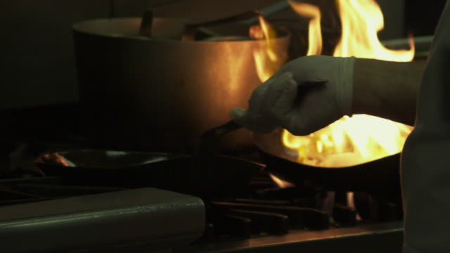 restaurant saute pans catching fire. - saute stock videos and b-roll footage
