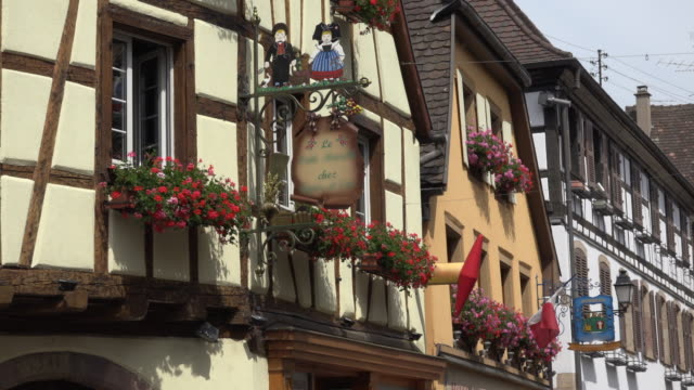 Restaurant sign on half-timbered house in a picturesque village