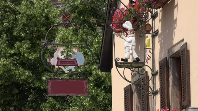 restaurant sign with cook and guests - french restaurant stock videos & royalty-free footage