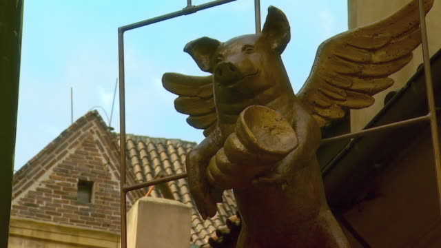 CU TD Restaurant sign with statue of pig / Prague, Czech Republic