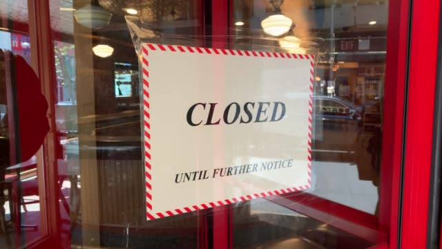 restaurant stands empty and closed in a shuttered business district in brooklyn on may 12, 2020 in new york city. across america, people are reeling... - shutter stock videos & royalty-free footage