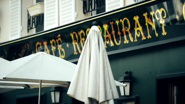 restaurant umbrellas in montmartre - patio stock-videos und b-roll-filmmaterial