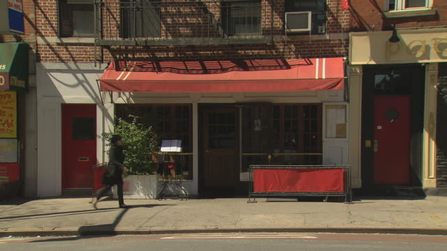 TS Restaurant with awning, pedestrian crosses, TU to building / New York, New York, USA