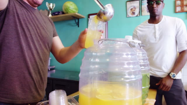 restaurant worker serving agua fresca - mexican restaurant stock videos & royalty-free footage