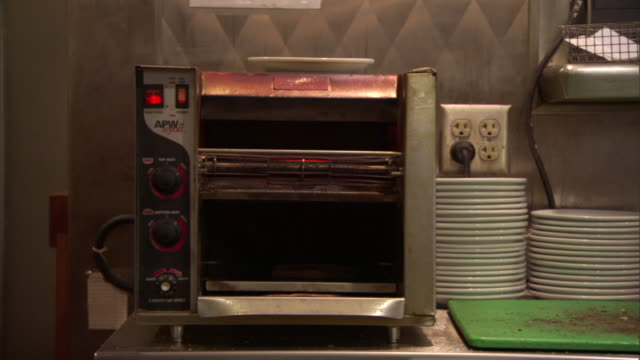 ms restaurant-grade toaster on counter next to stack of plates/ reno, nevada - stack of plates stock videos & royalty-free footage