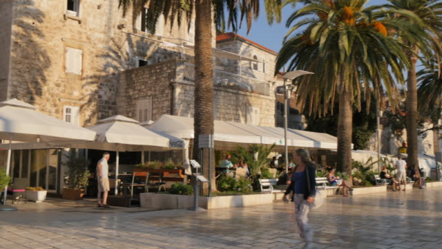 Restaurants along harbourside promenade, Hvar, Hvar Island, Dalmatia, Croatia, Europe