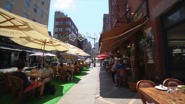 restaurants and bars set tables and chairs on the street and keep social distancing each other and prepare to phase three opening. - dining stock videos & royalty-free footage