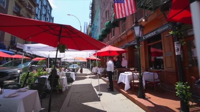 restaurants and bars set tables and chairs on the street and keep social distancing each other and prepare to phase three opening. - italian culture stock videos & royalty-free footage