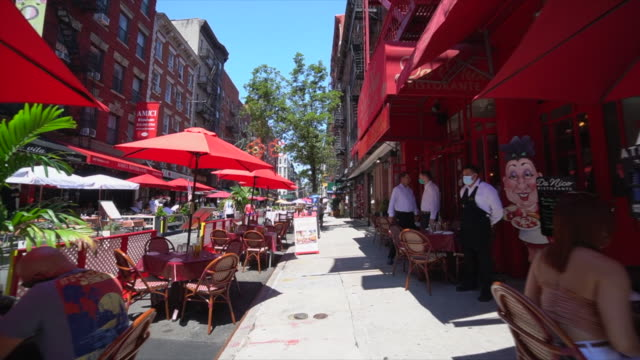restaurants and bars set tables and chairs on the street and keep social distancing each other and prepare to phase three opening. - other stock videos & royalty-free footage