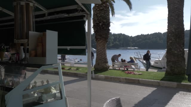 restaurants and cafes in cavtat harbour and bay, cavtat, dubrovnik riviera, croatia, europe - ice cream cone stock videos & royalty-free footage