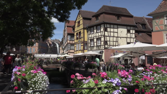 Restaurants in old town with half-timbered house at canal