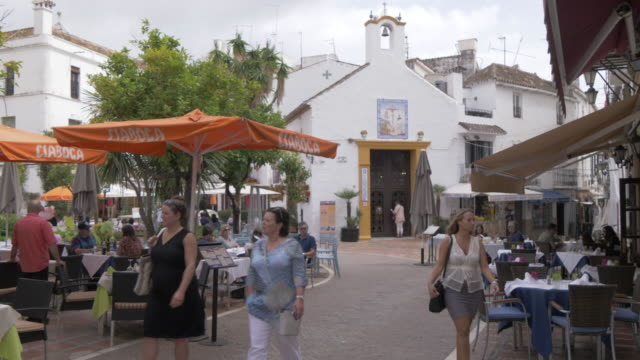 restaurants in plaza de los naranjos, old town, marbella, andalucia, spain, europe - pavement cafe stock videos & royalty-free footage