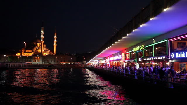 ws restaurants on galata bridge and new mosque (yeni mosque) illuminated at night / istanbul, turkey - yeni cami mosque stock videos and b-roll footage