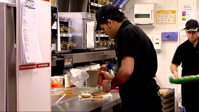 restaurants to display calorie counts on menus england london int kitchen worker squirting ketchup onto burger in fast food restaurant tomato sauce... - squirting stock videos and b-roll footage