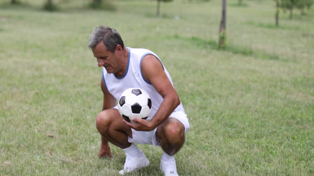 Ruhen Sie sich nach einem Fußball-Spiel