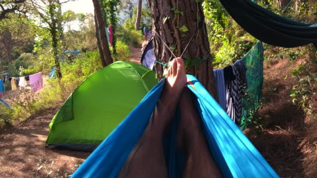vídeos de stock e filmes b-roll de resting in hammock during camping vacations in spain. - cama de rede