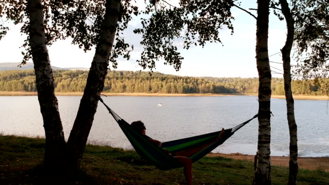 resting in nature on hammock.drone footage - reclining stock videos & royalty-free footage