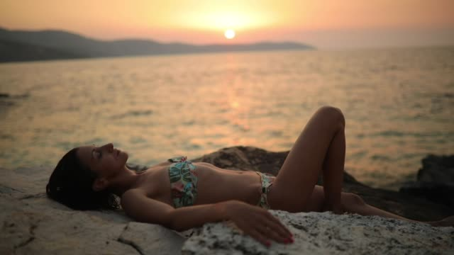resting on a cliff - back lit stock videos & royalty-free footage