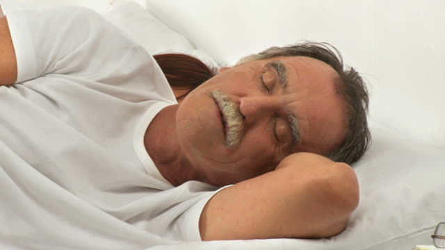 hd dolly: restless sleeping - snoring stock videos and b-roll footage