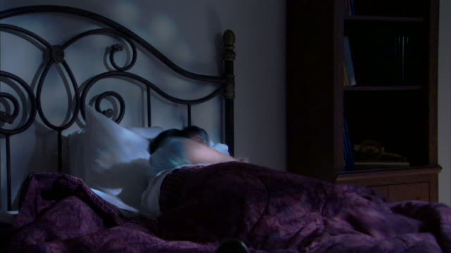 restless woman in bed - restlessness stock videos & royalty-free footage