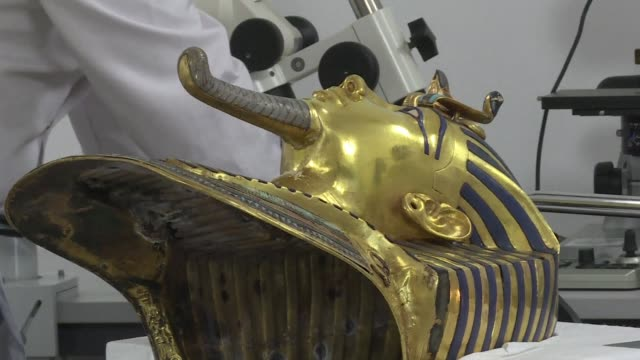 restoration experts aim to have removed a crust of dried glue from the beard of boy pharaoh tutankhamuns priceless golden mask by the end of the year... - pharaoh stock videos & royalty-free footage