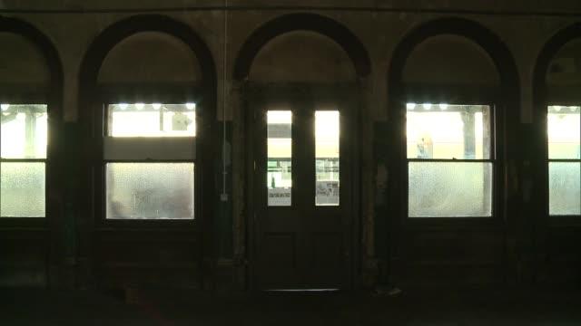 vídeos de stock e filmes b-roll de restoration of peckham rye railway station to begin england london peckham rye railway station ext people along outside peckham rye station benedict... - peckham