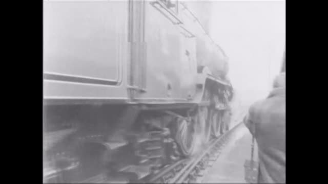 restored flying scotsman steam engine makes journey between london and york fs220269010 / b/w flying scotsman engine along tracks flying scotsman... - 1973 stock-videos und b-roll-filmmaterial