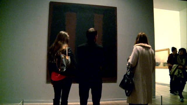 restored rothko painting returns to tate modern england london tate modern int people looking at painting on wall of gallery black on maroon painting... - 復元する点の映像素材/bロール
