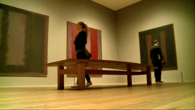 Restored Rothko painting returns to Tate Modern Low angle view people along in gallery room looking at Rothko artworks People chatting and pointing...