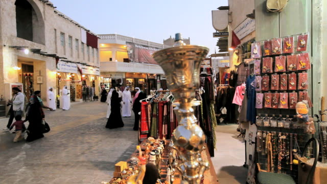 ms pan restored souq waqif with mud rendered shops and exposed timber beams / doha, qatar - ad dawhah stock-videos und b-roll-filmmaterial