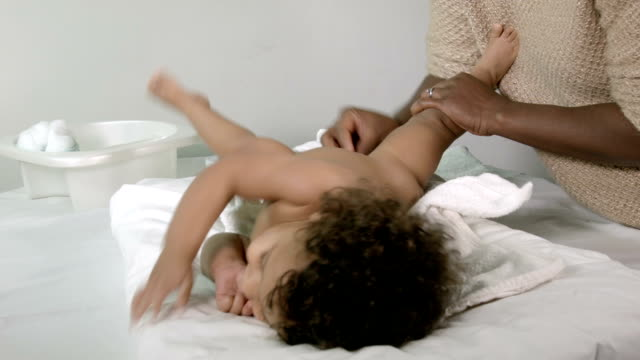 hd: resuable nappy diaper changing - diaper stock videos and b-roll footage