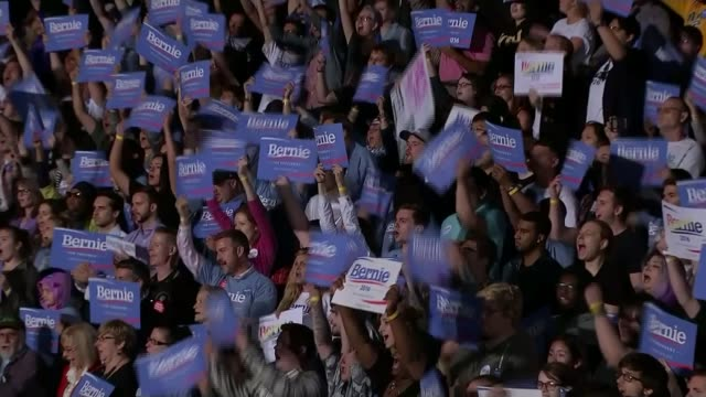 results of iowa caucus as donald trump finishes second; date unknown usa: int bernie sanders onto stage at rally to applause sot supporters with... - 研磨器点の映像素材/bロール