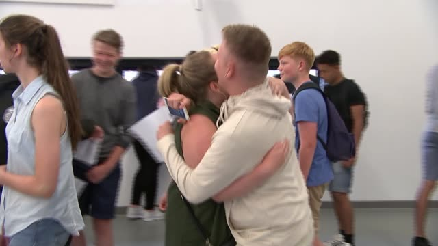 results show decline in grades achieved; vox pop student beth potter interview sot various shots students hugging parents and friends vox pops... - 一般教育証明試験点の映像素材/bロール