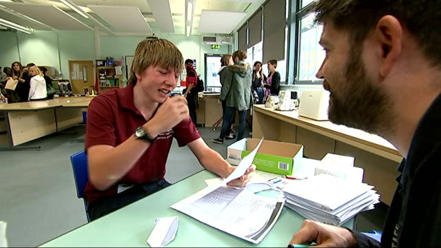 top grades rise but english scores fall england gloucester severn vale school int james jones taking seat at table in corner of classroom zoom in... - 女性教師点の映像素材/bロール