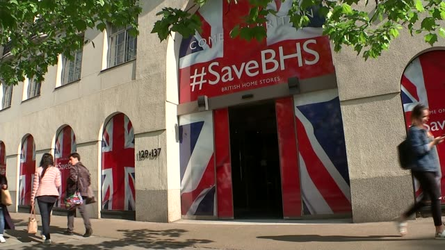 stores to close as rescue bid fails; 'come on britian #save bhs' signs outside head offices and people past staff towards through doors with 'save... - offerta d'asta video stock e b–roll