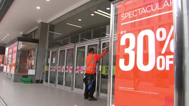 bhs stores to close as rescue bid fails england south yorkshire sheffield ext man window cleaner cleaning entrance doors of bhs store large sign in... - cent sign stock videos & royalty-free footage