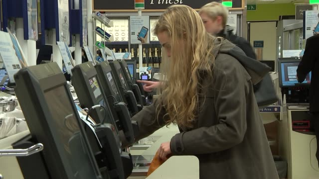 tesco reports an annual jump in sales retail tesco reports an annual jump in sales london bridge tooley street people at selfcheckout tills - self service stock videos & royalty-free footage