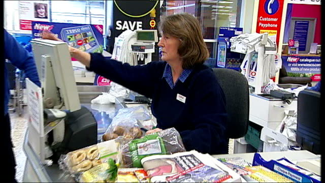 Tesco supermarket general views Tesco checkouts/tills showing Tesco staff scanning items through till customers bagging up their purchases / General...