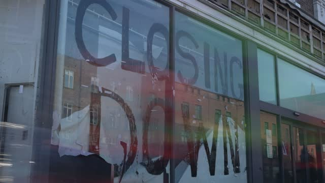 retail's store sports direct has a window painted with a closing down sign on the window due to the coronavirus covid-19 pandemic in camden on march... - video stock videos & royalty-free footage