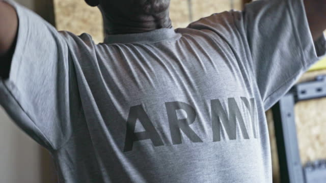 retired black army man working out in home gymnasium - shirt stock videos & royalty-free footage