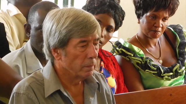 retired british man appeared in a ugandan court monday on charges of trafficking obscene publications after police found private pictures of him... - kampala stock-videos und b-roll-filmmaterial