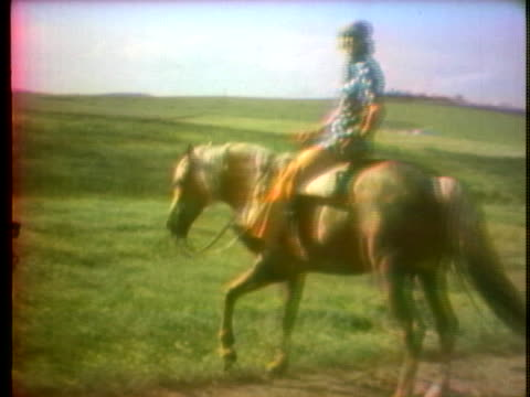 retired bullfighter manuel benitez rides a horse along a dirt road. - ranch stock videos & royalty-free footage